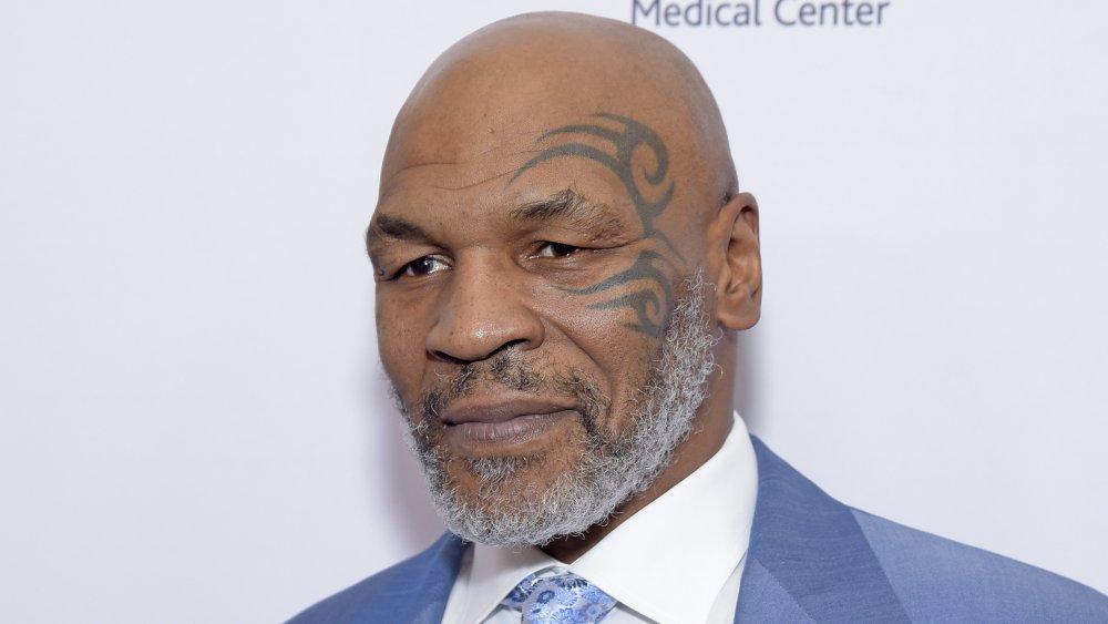 Mike Tyson und sein charakteristisches Gesicht Tattoo
