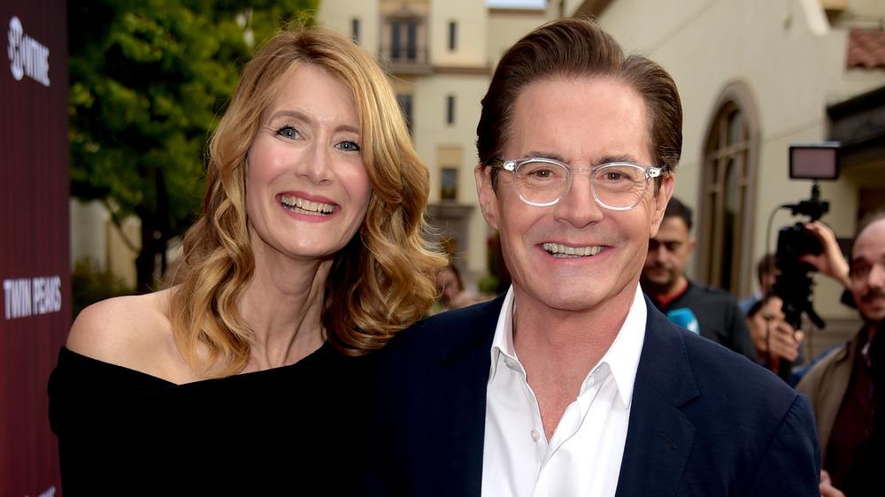 Laura Dern und Kyle MacLachlan lächeln