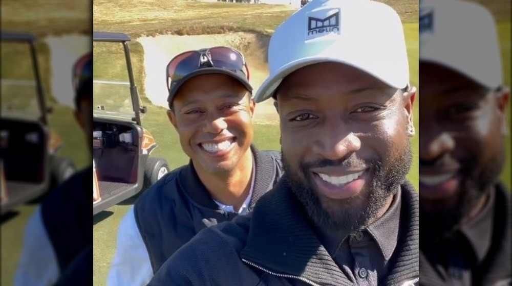 Dwyane Wade Tiger Woods lächelt
