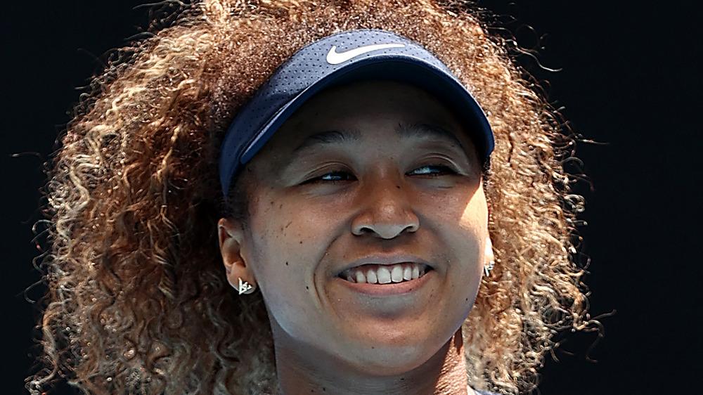 Naomi Osaka lächelt nach dem Sieg