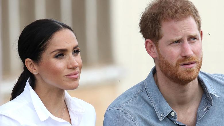 Meghan Markle und Prinz Harry lächeln