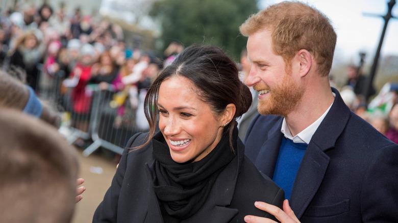 Meghan Markle und Prinz Harry begrüßen die Zuschauer