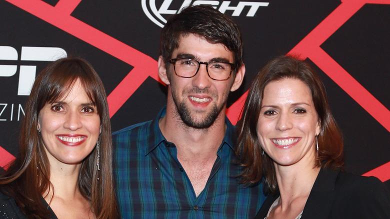 Hilary, Michael und Whitney Phelps posieren